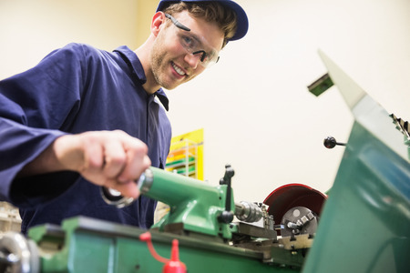 boiler suit: Engineering student using heavy machinery at the university