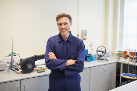 boiler suit: Engineering student smiling at camera at the university