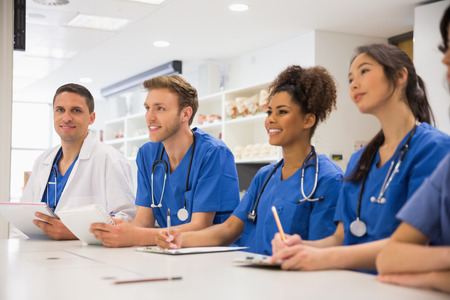 medical student: Medical student smiling at the camera during class at the university Stock Photo