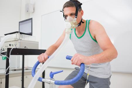 test: Man doing fitness test on exercise bike at the medical centre