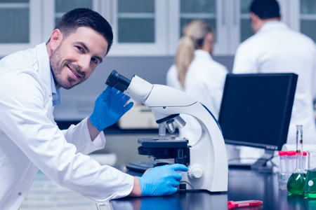 rubber: Science student working with microscope in the lab at the university