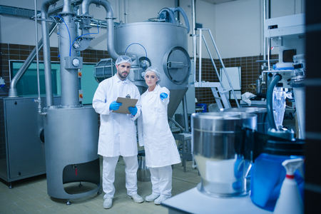 food processing: Food technicians working together in a food processing plant