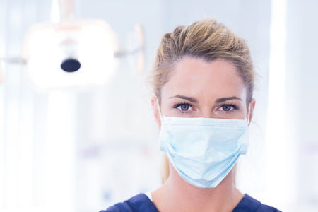 dentists surgery: Portrait of a dentist in mask looking at camera at the dental clinic