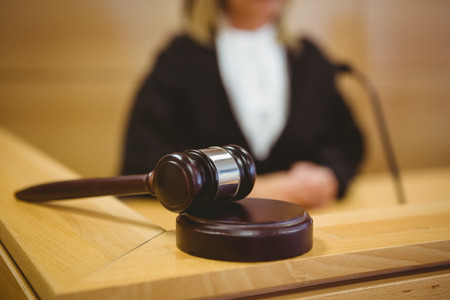 court judge: Gavel resting on sounding block in the court room