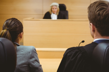 trial indoor: Judge talking with lawyers to make a decision in the court room Stock Photo