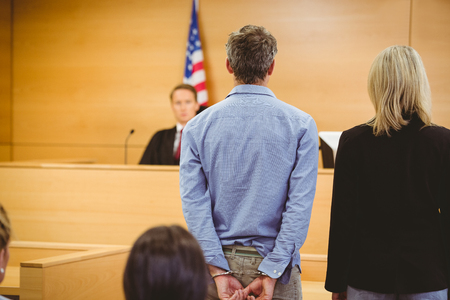 courtroom: Criminal waiting for courts ruling in the court room