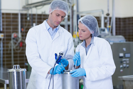 biologist: Focused biologist team working together in the factory