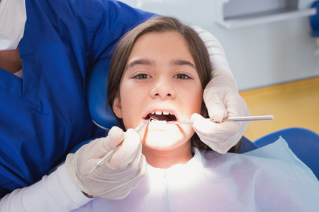 dental examination: Scared young patient in dental examination in clinic Stock Photo