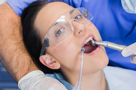 mouth  open: Portrait of a patient her mouth open with tools in dental clinic Stock Photo
