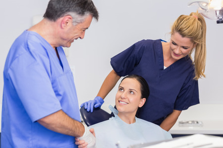 introducing: Dentist and nurse introducing a patient in dental clinic
