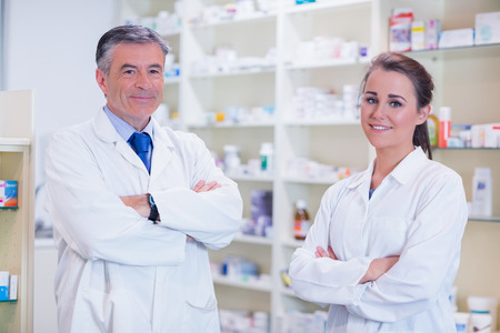Pharmacist With His Trainee Standing With Arms Crossed In The ...
