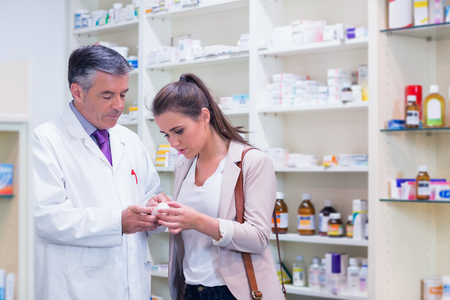 pharmacist: Pharmacist and customer talking about medication in the pharmacy