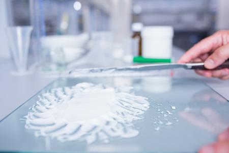 biochemist: Close up of a biochemist preparing some medicine in laboratory Stock Photo