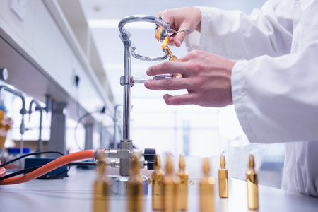 biochemist: Close up of a biochemist sealing a vial in laboratory