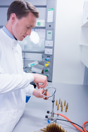 Focused Biochemist Sealing A Vial In Laboratory Stock Photo, Picture ...