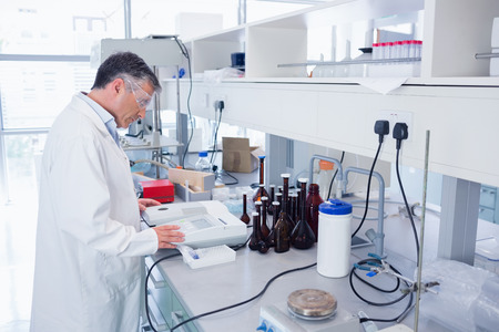 pharmaceutical: Scientist carrying out an experiment in laboratory