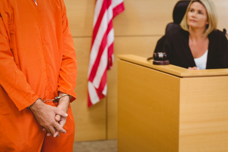 court room: Judge looking the condemned prisoner in the court room