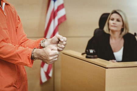 Close up of a prisoner wearing handcuffs in the court room photo