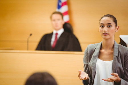 trial: Serious lawyer make a closing statement in the court room