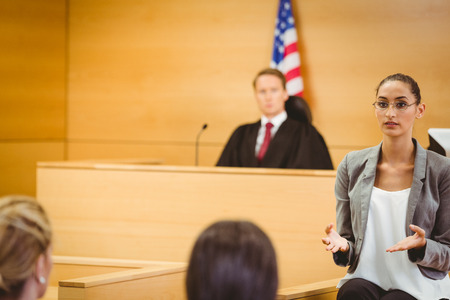 court room: Serious lawyer make a closing statement in the court room
