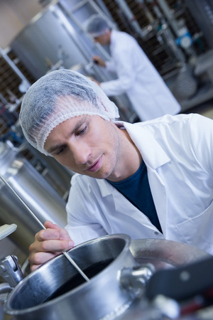 microbrewery: Close up of a man wearing a hair net in the factory Stock Photo