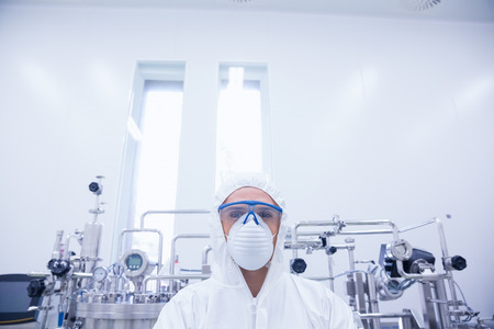 protective suit: Portrait of a scientist in protective suit in the factory Stock Photo