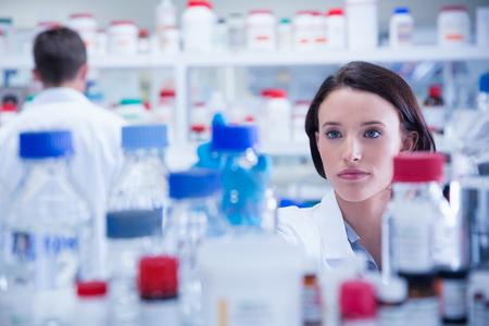 medical sample: Portrait of a chemist behind medical sample in lab