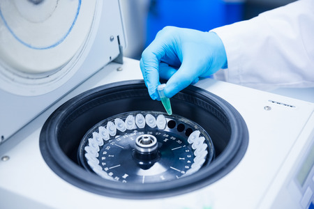 centrifuge: Close up of a chemist using a centrifuge in lab Stock Photo