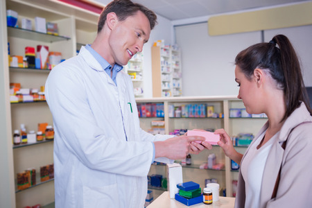 pharmacist: Pharmacist and customer discussing a product in the pharmacy