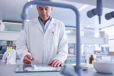 biochemist: Focused biochemist preparing some medicine in laboratory Stock Photo