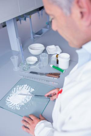 biochemist: Biochemist standing while preparing some medicine in laboratory