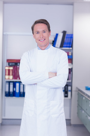 biochemist: Portrait of a smiling biochemist standing with arms crossed in laboratory