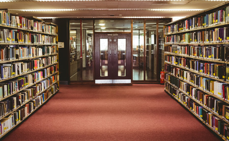 Entrance to the college library in the university Editorial