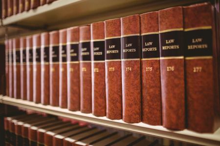 law: Close up of a lot of law reports in library Stock Photo