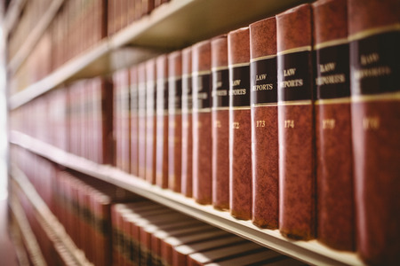 shelves: Close up of a lot of law reports in library Stock Photo