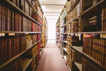 Close up of a bookshelf in library Archivio Fotografico