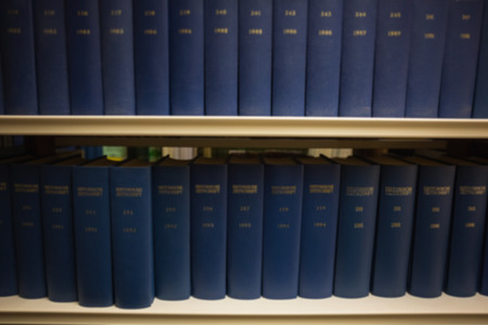 volumes: Volumes of books on bookshelf in library at the university Stock Photo