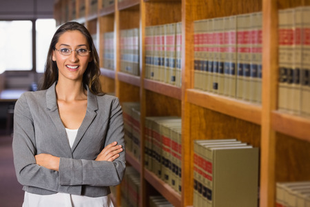 law school: Pretty lawyer in the law library at the university