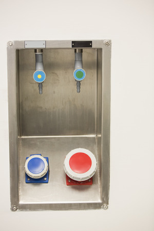 pharmaceutic: Blue and red buttons on the wall at the laboratory Stock Photo