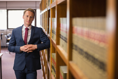 Handsome lawyer in the law library at the university Stock Photo