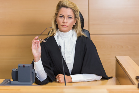 Stern judge looking at camera in the court room Banco de Imagens