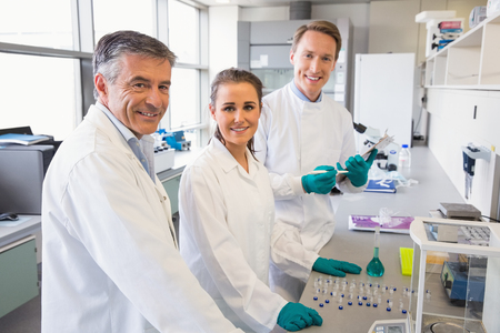 scientist woman: Team of scientists working together at the laboratory Stock Photo