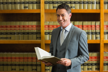 lawyer: Lawyer holding book in the law library at the university