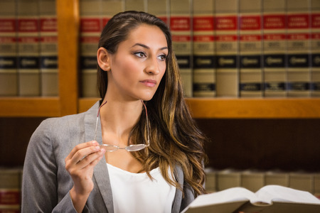 law library: Pretty lawyer reading in the law library at the university