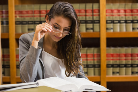 law library: Pretty lawyer in the law library at the university