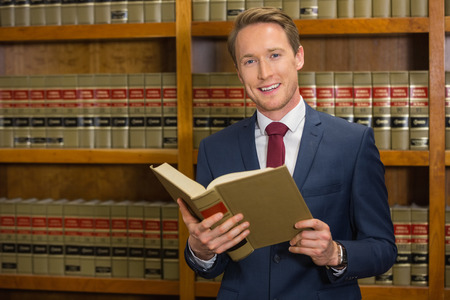 law library: Handsome lawyer in the law library at the university Stock Photo