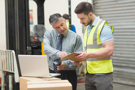 manager: Portrait of manual workers scanning package in the warehouse Stock Photo