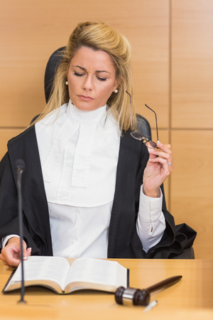 sentencing: Stern judge reading her notes in the court room