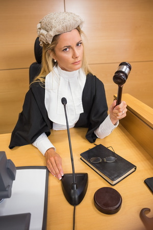 banging: Stern judge banging her hammer in the court room