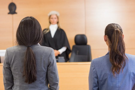 judges: Lawyers listening to the judge in the court room Stock Photo